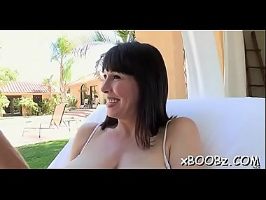 Cock-riding scene with a breasty lady