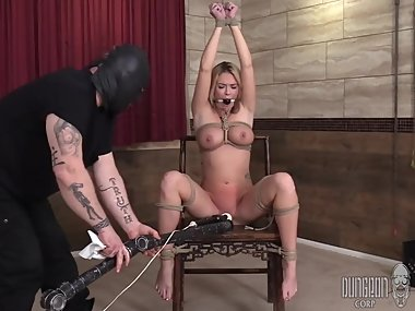 beautiful busty babe in bdsm play