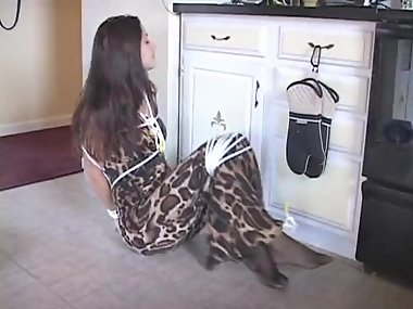 Woman in maxi dress suprised at home and tied up