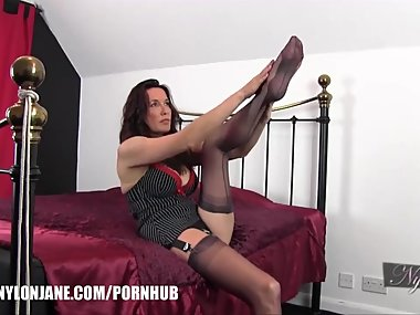 Milf slips her long legs inside silky nylon stockings and feet in..