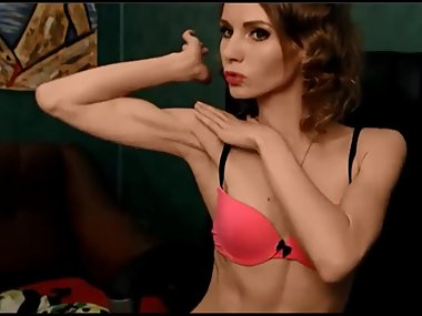 Slender Russian cam girl flexes her biceps
