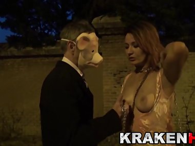 Man with pig mask in a outdoor scene with a MILF