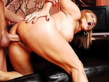 Pierced Milf gets a tasty mouthful from her..