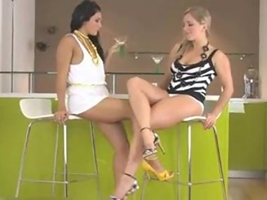 Brunette worships sexy blonde with thick legs in..